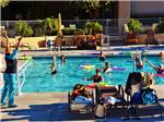 View larger image of People swimming in the pool at SUNFLOWER RV RESORT image #3