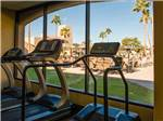 View larger image of Treadmills looking through window to community area at SUNFLOWER RV RESORT image #10