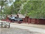View larger image of Row of log cabins with patios at SHADY ACRES RV PARK image #8