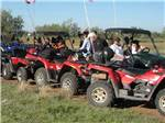 View larger image of Row of people in red ATVs at ARIZONIAN RV RESORT image #10