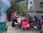 View larger image of Family camping in trailer at KATAHDIN SHADOWS CAMPGROUND  CABINS image #2