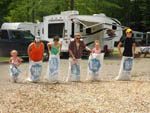 View larger image of Potato sack race at KATAHDIN SHADOWS CAMPGROUND  CABINS image #6