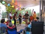 View larger image of Campers being entertained by a band at ASHEVILLE BEAR CREEK RV PARK image #4