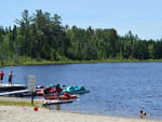 View larger image of Men fishing at MOUNTAIN LAKE CAMPING RESORT image #6