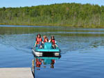 View larger image of Girls paddle boating at MOUNTAIN LAKE CAMPING RESORT image #7