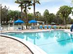 View larger image of Swimming pool with outdoor seating at TAMPA EAST RV RESORT image #6