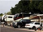 View larger image of A row of RVs parked in spaces at BONITA MESA RV RESORT image #6