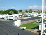 View larger image of Many RVs and mobile homes lining paved road of campground at SHANGRI-LA RV RESORT image #4