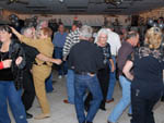 View larger image of Large group of adults enjoying a themed dance night at SHANGRI-LA RV RESORT image #8