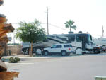View larger image of White Ford Explorer parked in front of white and gray RV at SHANGRI-LA RV RESORT image #9