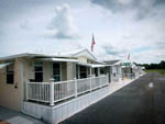 View larger image of Lodging with flag poles at LITTLE WILLIES RV RESORT image #5