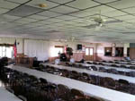 View larger image of Many tables and chairs in large clubhouse at LITTLE WILLIES RV RESORT image #9