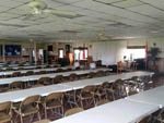 View larger image of Rows of tables and chairs in clubhouse at LITTLE WILLIES RV RESORT image #10