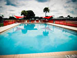 View larger image of Swimming pool with outdoor seating at LITTLE WILLIES RV RESORT image #11