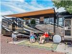 View larger image of Couple camping in RV at VENTURE IN RV RESORT image #4