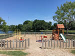 View larger image of Playground with swing set at HOUSTON WEST RV PARK image #2