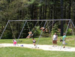 View larger image of Kids swinging at SANDY POND CAMPGROUND image #2