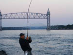 View larger image of Man fishing at SANDY POND CAMPGROUND image #6