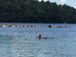 View larger image of Kids swimming on the lake at SANDY POND CAMPGROUND image #7
