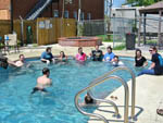 View larger image of People swimming in the pool at JUDE TRAVEL PARK OF NEW ORLEANS image #4