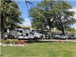 View larger image of RVs parked in shady sites at SPRING CREEK CAMPGROUND  TROUT RANCH image #3