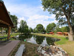 View larger image of Pond between row of cabins and pavilion at SPRING CREEK CAMPGROUND  TROUT RANCH image #5