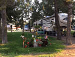 View larger image of Travel trailer parked next to flower garden area at JIM  MARYS RV PARK image #4