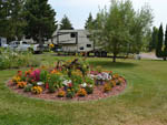 View larger image of Circle area of flowers with RV parked behind at JIM  MARYS RV PARK image #8