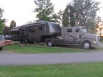 View larger image of Semi towing grey travel trailer parked at LA SALLE RV PARK image #2