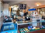 View larger image of Interior view of Deli counter and kitchen at RIO BEND RV  GOLF RESORT image #4
