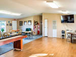 View larger image of Game room with tables and TV at RIO BEND RV  GOLF RESORT image #11