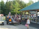 View larger image of People enjoying a wagon ride at TIMBERLAND ACRES RV PARK image #3