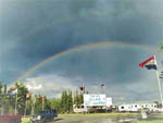 View larger image of A rainbow over the RV sites at TOK RV VILLAGE  CABINS image #2