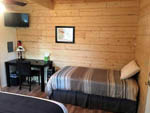 View larger image of The twin size bed in the cabin at TOK RV VILLAGE  CABINS image #7