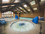 View larger image of Indoor pool and hot tub with skylights at CANNON BEACH RV RESORT image #3