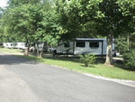 View larger image of Travel trailers parked underneath trees at CULLMAN CAMPGROUND image #9