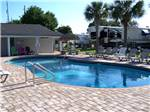 View larger image of The kidney shaped pool at EMERALD BEACH RV PARK image #3