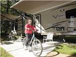 View larger image of Lady biking at CLOVER LEAF FOREST RV RESORT image #3