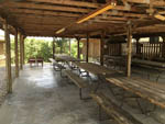 View larger image of Patio area with picnic tables at WANDERLUST RV PARK image #6