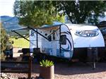 View larger image of Trailer parked in a shady site at ROYAL VIEW RV PARK image #6