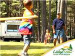 View larger image of Father playing baseball with children at LEDGEVIEW RV PARK image #3