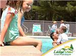 View larger image of Kids swimming in the pool at LEDGEVIEW RV PARK image #5
