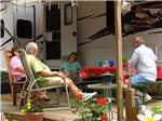 View larger image of Couples camping at LEDGEVIEW RV PARK image #8