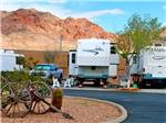 View larger image of A view of RV sites with mountains in the background at CANYON TRAIL RV PARK image #3
