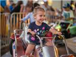View larger image of A small child on a ride at FAIRPLEX RV PARK FORMERLY LOS ANGELESPOMONA KOA image #4