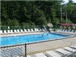View larger image of Swimming pool with outdoor seating at TWIN TAMARACK FAMILY CAMPING  RV RESORT image #1