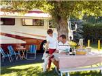 View larger image of Couple camping in RV at CARSON VALLEY RV RESORT  CASINO image #3