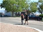 View larger image of Couple walking on paved road at AMERICAN RV RESORT image #8