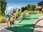 View larger image of A man and small child playing mini golf at CHERRY HILL PARK image #5
