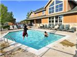 View larger image of Kids swimming in the pool at PREMIER RV RESORTS - EUGENE image #4